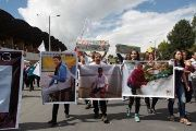 Relatives and friends hold pictures of Ecuadorean journalists who were kidnapped near the Colombian border, during a protest march to demand for their release.