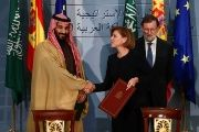 Saudi Arabia's Crown Prince Mohammed bin Salman shakes hands with Spain's Defence Minister Maria Dolores de Cospedal after signing a framework deal as Spain's Prime Minister Mariano Rajoy looks on at the Moncloa Palace in Madrid, Spain, April 12, 2018.