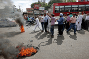 "Anti-Muslim demonstrators shut down much of the town of Kathua in northern India on Wednesday. One woman said that if Hindu men accused of raping and killing a Muslim child are not released, ""We will burn ourselves.''"