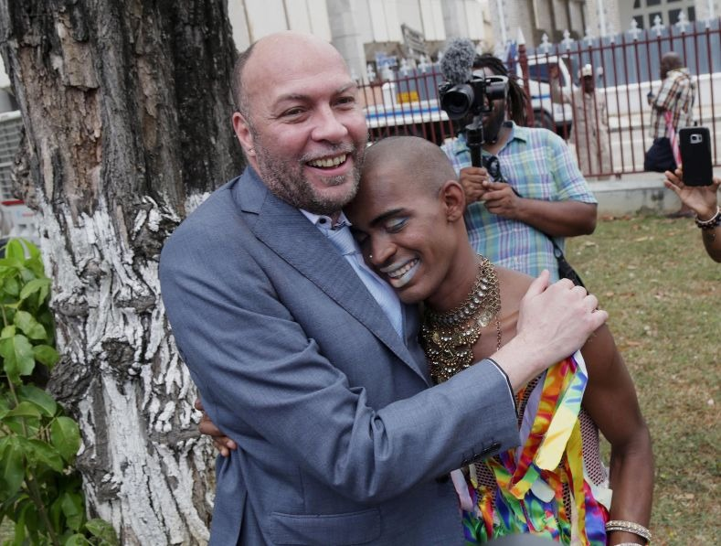 Jason Jones, an activist in the LGBT community, hugs a supporter. In February 2017, Jones filed a landmark lawsuit against the government to overturn Sections 13 and 16 of the Sexual Offenses Act, according to which anyone