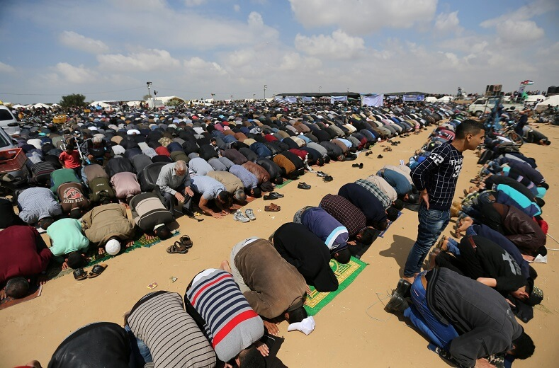 Palestinians pray on a Friday, before protests begin.