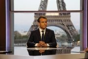 French President Emmanuel Macron poses on the TV set before an interview with French journalists at the Theatre National de Chaillot in Paris, France, April 15, 2018.