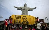 Supporters of former Brazilian President Luiz Inacio Lula da Silva display a banner in front of the statue of Christ the Redeemer in Rio de Janeiro, Brazil April 14, 2018