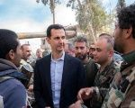 Syrian President Bashar al-Assad meets with Syrian army soldiers in eastern Ghouta, Syria, March 18, 2018.