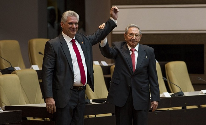 Cuba's new President Miguel Diaz-Canel stands at the country's National Assmely with former President Raul Castro.