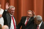 Newly elected Cuban President Miguel Diaz-Canel (L) and former Cuban President Raul Castro wave during the National Assembly in Havana, Cuba, April 19, 2018.