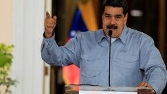 A session of Venezuela's legislature, temporarily disqualified for disregarding the Supreme Court, has approved discussion of Maduro's theoretical removal from office.