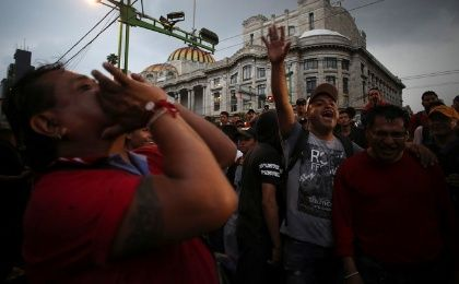 People yell during a protest against leftist front-runner Andres Manuel Lopez Obrador of the National Regeneration Movement (MORENA) during the first presidential debate outside Bellas Artes palace in Mexico City, Mexico April 22, 2018