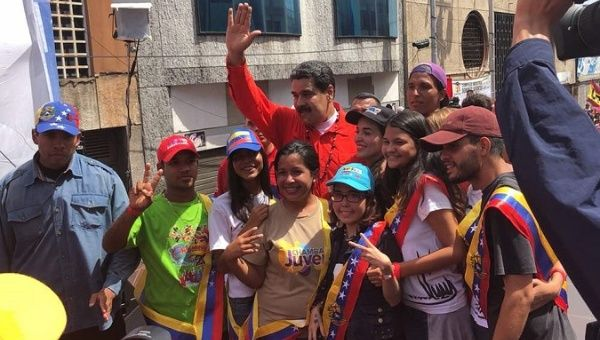 Venezuelan President Nicolas Maduro poses for photos with residents of Bolivar state after speaking to the press at the launch of his electoral campaign.