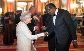 The Prime Minister of Antigua and Barbuda Gaston Browne (Right) meets with Queen Elizabeth II.