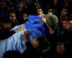 People carry the body of Palestinian journalist Ahmed Abu Hussein, 24, who died of wounds he sustained while covering a protest along the Gaza-Israel border.