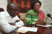 Opposition Leader Mia Mottley (right) speaking during a recent press conference, as Shadow Minister of Health Dwight Sutherland sits beside her.