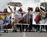 Relatives and friends hold pictures of Ecuadorean photojournalist Paul Rivas (left), journalist Javier Ortega (center) and their driver Efrain Segarra during a protest march to demand their release, in Quito, Ecuador April 1, 2018.