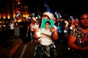 A woman holds a picture of Alvaro Manuel Conrado Davila, one of the victims killed during the protests in Managua.