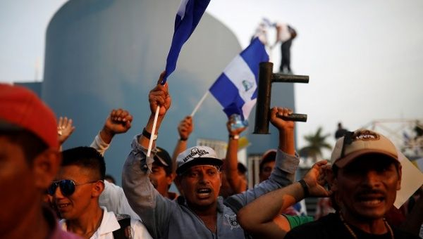 Thousand of protesters marched yesterday to demand an end to violence at the Metropolitan Cathedral in Managua, Nicaragua, April 28, 2018.
