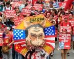 Protesters carry an effigy bearing an image of President Rodrigo Duterte while marching towards the Malacanang Presidential Palace during a May Day rally at Espana, metro Manila, Philippines May 1, 2018.