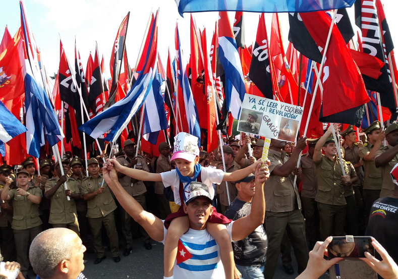 People wave the Cuban flag during the celebrations.
