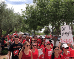 Participants take part in a march in Phoenix, Arizona, U.S., April 30, 2018 in this picture obtained from social media.