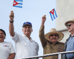 Cuba's Secretary of the Communist Party in Havana Lazara Mercedes Lopez (L), Cuba's President Miguel Diaz-Canel (2-L), the first Secretary of the Communist Party and former President Raul Castro (2-R),and pre12-yearof the Communist Party of Chile Guillermo Teillier watch the May Day rally in Havana, Cuba. Photo: Reuters