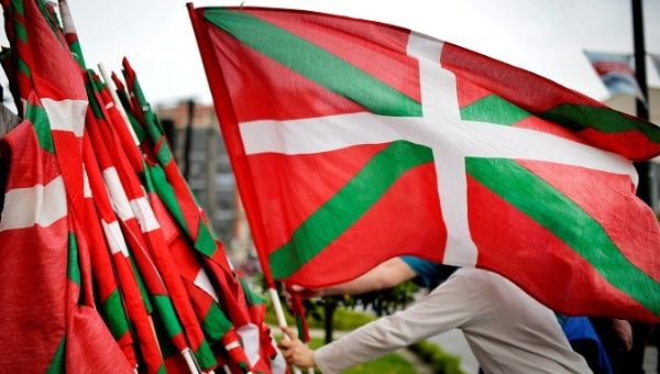 A man lays down a Basque flag at the end of a rally in support of ETA prisoners in Bilbao, April 21.