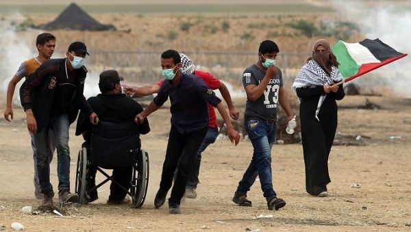 Protesters at Friday of Workers demonstrations along the Gaza-Israel border.