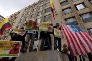 Supporters of Seuxis Paucias Hernandez, better known by his alias Jesus Santrich, hold posters asking for his freedom during a rally commemorating May Day in Bogota, Colombia May 1, 2018.