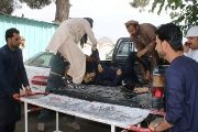 People carrying an injured man to a hospital after a blast at a mosque in Khost province, Afghanistan May 6, 2018