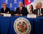 U.S. Vice President Pence sits between OAS Secretary General Almagro and President Gonzalez Diazas he waits to address the body in Washington.