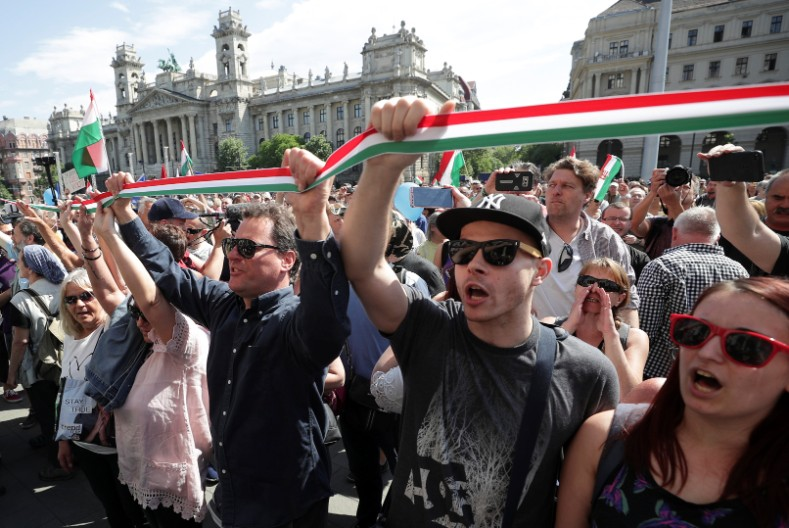 Protesters shout slogans during a rally as members of parliament hold the opening session after the recent election in Budapest, Hungary May 8, 2018.