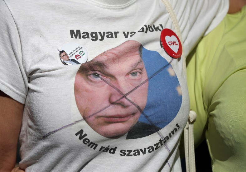A participant wears a T-shirt, depicting Hungarian Prime Minister Viktor Orban, during a protest near the building of parliament, which holds the opening session after the recent election in Budapest, Hungary May 8, 2018.