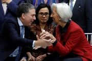 Indonesian Finance Minister (C) reacts as IMF Director Lagarde greets Argentina's Treasury Minister Dujovne during the IMF/World Bank spring meeting in Washington.