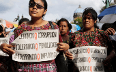 A group of women protest against the government of Jimmy Morales infront of the national palace in Guatemala City.