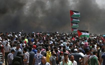 Palestinian demonstrators gather during a protest against U.S. embassy move to Jerusalem and ahead of the 70th anniversary of Nakba, at the Israel-Gaza border in the southern Gaza Strip May 14, 2018.