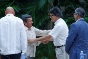 Colombia's ELN negotiator Pablo Beltran and government negotiator Gustavo Bell shake hands during peace talks in Havana, Cuba.
