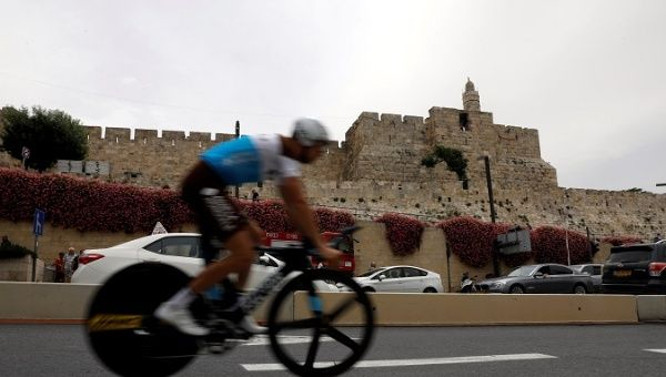 A rider practises opposite to the David Tower of Jerusalem