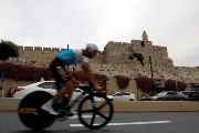 A rider practises opposite to the David Tower of Jerusalem's Old City before the beginning of Stage 1.