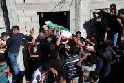 Mourners carry the body of a Palestinian, who was killed during a protest at the Israel-Gaza border, during his funeral in Khan Younis in the southern Gaza Strip.