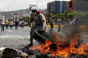 Demonstrators build a fire barricade on a street in Caracas, Venezuela April 10, 2017.