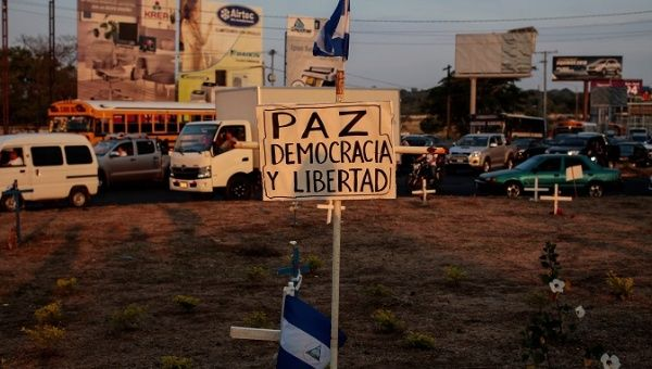 "A sign reading "" Peace, Democracy and Freedom"" is seen during a protest in Managua, Nicaragua May 7, 2018"