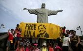 Supporters of former Brazilian President Luiz Inacio Lula da Silva display a banner in front of the statue of Christ the Redeemer in Rio de Janeiro, Brazil April 14, 2018.