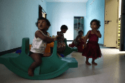 Baby girls play inside the Life Line Trust orphanage in Salem in the southern Indian state of Tamil Nadu June 20, 2013.