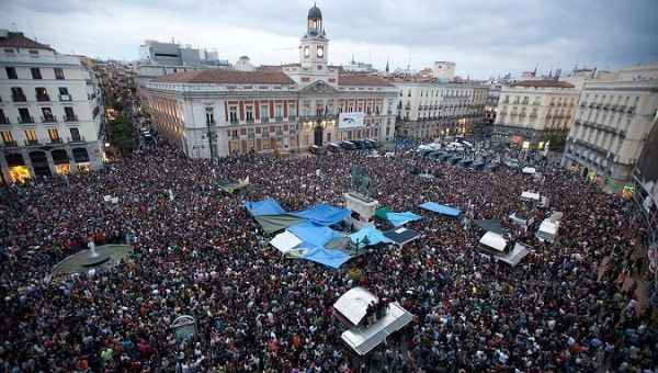 Demonstrators gather and shout slogans in Madrid