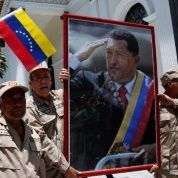 A man holds a portrait of late Venezuelan President Hugo Chavez during a rally in Caracas.