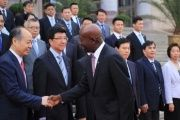 Chinese officials in Beijing welcome Trinidad and Tobago's Prime Minister Keith Rowley.