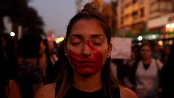 Women in Chile protest agains femicides. Femicides and gender-based violence continues to plague Latin America.