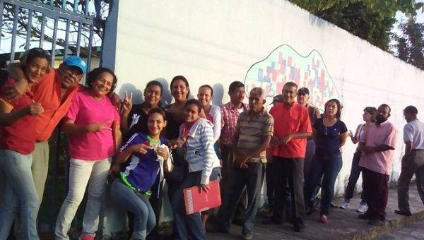 Venezuelans queue to vote on election day.