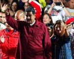 Venezuela's President Maduro stands with supporters after the results of the election were released in Caracas.
