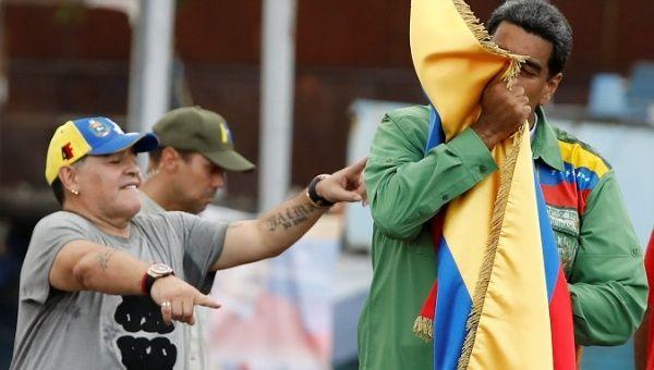 Ex-Argentine soccer player Diego Armando Maradona gestures as Venezuela