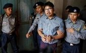 Detained Reuters journalist Wa Lone leaves the court handcuffed, in a police vehicle, after a hearing in Yangon, Myanmar May 21, 2018.