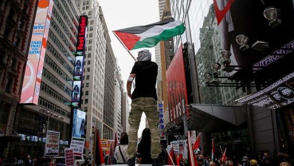 A demonstrator waves a Palestine flag during a pro-Palestine rally in New York City, U.S., May 18, 2018.